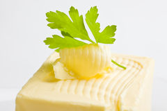 Curled Butter with parsley Stock Photo