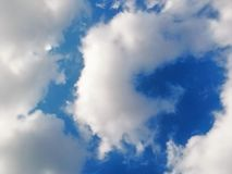 Curled cloud on blue sky background Royalty Free Stock Photography