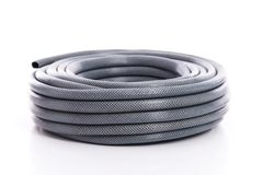 Curled garden hose on white. Background royalty free stock photos