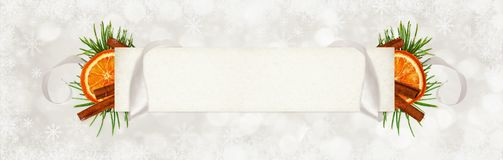 Curled gray silk ribbon and a paper card for text with Christmas stock image