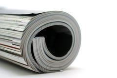 Curled magazine isolated on white background. Royalty Free Stock Photos