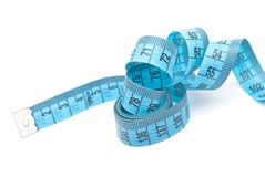 Curled measuring tape Royalty Free Stock Image