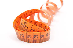 Curled measuring tape Royalty Free Stock Images