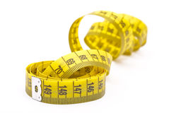 Curled measuring tape Stock Images