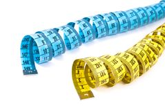 Curled measuring tapes Stock Photo