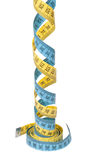 Curled measuring tapes Royalty Free Stock Photo