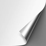 Curled Metalic Corner of Paper on Gray Background Royalty Free Stock Photo