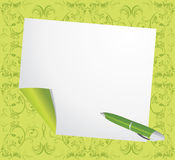 Curled page and ballpen on the green background Stock Images