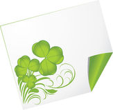 Curled page with clover Royalty Free Stock Images