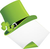 Curled page and St. Patrick's Day hat with clover Royalty Free Stock Images