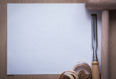 Curled planning chips firmer chisel wooden mallet and blank shee Royalty Free Stock Photography