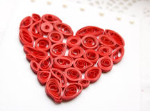 Curled red heart made from paper Stock Image