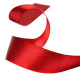 Curled Red Ribbon over White Stock Images