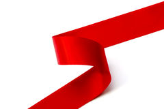Curled Red Ribbon over White Background Royalty Free Stock Photo