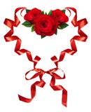 Curled red silk ribbons in a hart shape with rose flowers arrangement for Valentine's Day. Isolated on white background stock image