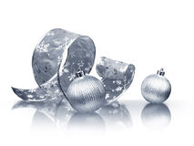 Silver ribbon and Christmas balls Stock Photos