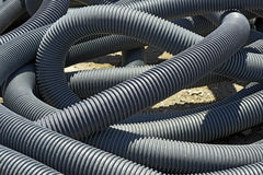 Curled stack of electrical conduit in patio construction. MAUA, SP, BRAZIL - FEBRUARY 26, 2015 stock photography