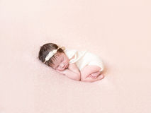 Curled Up Baby In Knitted Pastel Costume Stock Images