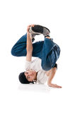 Curled up breakdancer. Young happy breakdancer standing upside down curled up royalty free stock photography