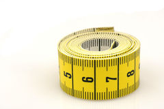 Curled up tape measure. Isolated on a white background Stock Images