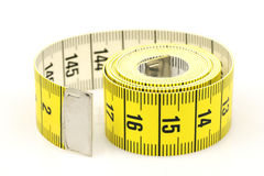 Curled up tape measure. Isolated on a white background Stock Image
