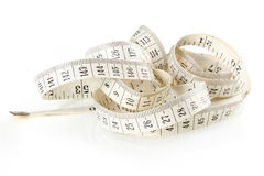 Curled white measuring tape Royalty Free Stock Photography
