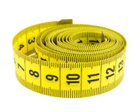 Curled yellow measuring tape Stock Photo