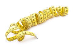 Curled yellow measuring tape Royalty Free Stock Photo