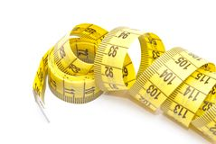 Curled yellow measuring tape Stock Images