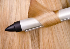 Curler and blond hair. In the hairdresser saloon Stock Photo
