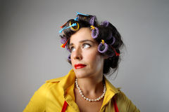 Curlers. Portrait of housewife with curlers royalty free stock photos