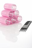 Curlers and comb Royalty Free Stock Images