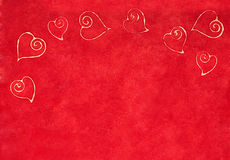 Curlicue hearts on a red background Stock Photography