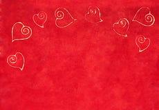 Curlicue serca na czerwonym tle Fotografia Stock
