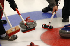 Curling. Team Curling on the Ice Stock Image