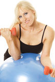 Curling exerciser leaning on ball Royalty Free Stock Images