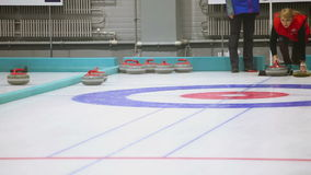 Curling game. Winter Olympic sport. NOVOSIBIRSK, RUSSIAN FEDERATION - JANUARY, 2016: Unsuccessful attempt for player to launch a stone on ice stock video footage