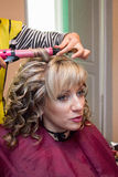 Curling hair in beauty salon Stock Photos