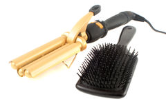 Curling iron and brush Royalty Free Stock Images
