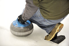 Curling-Launching the Rock. Royalty Free Stock Photo