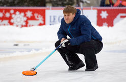 Curling player D. Abanin Royalty Free Stock Images