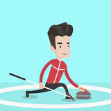 Curling player playing curling on curling rink. Royalty Free Stock Images