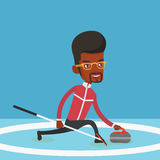 Curling player playing on the rink. Stock Photos