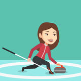 Curling player playing on the rink. Royalty Free Stock Image