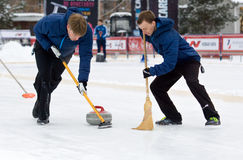 Curling players D. Abanin (L) and A. Kirikov (R). MOSCOW - JANUARY 17, 2016: Curling players D. Abanin (L) and A. Kirikov (R) in action on Russian Curling royalty free stock photography