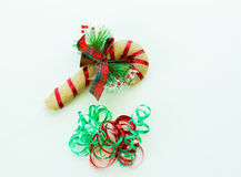 Curling ribbon and plush candy cane isolated on white Royalty Free Stock Images