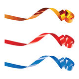 Curling ribbons. Gold, red and blue curling ribbons isolated on white for design Royalty Free Stock Image