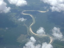 Curling river with sand berms from above stock images