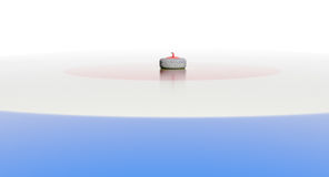 Curling rock in center of house. Curling rock dead center of circles Royalty Free Stock Photo