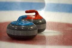 Curling rocks in the house Royalty Free Stock Photo